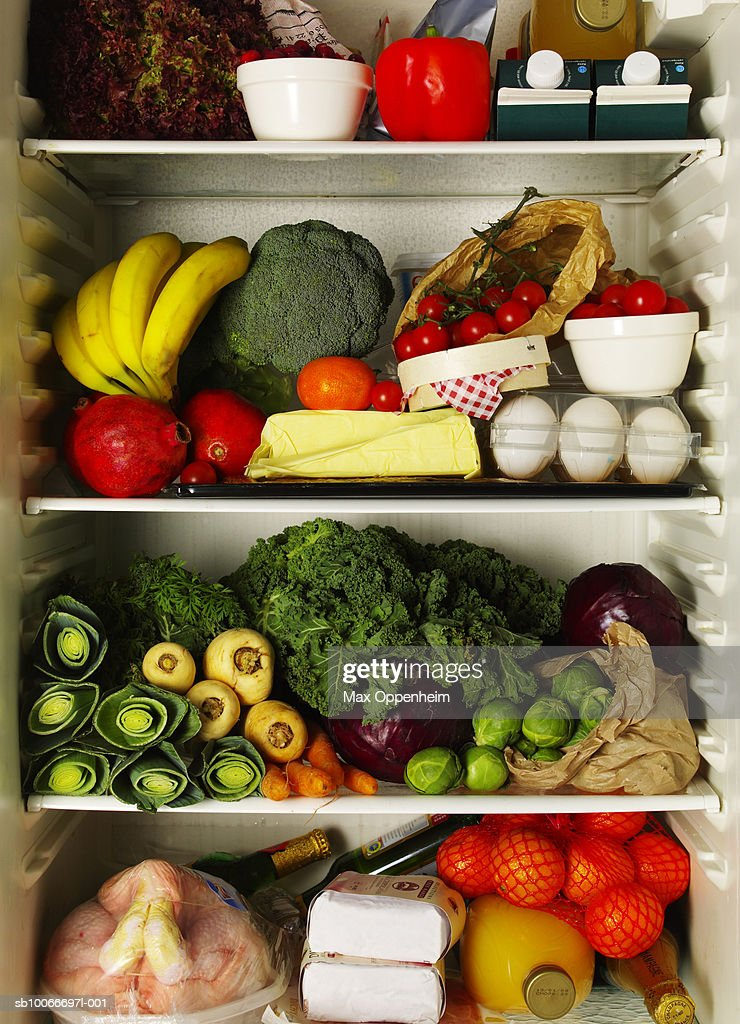 Refrigerator full of ingredients : Stock Photo