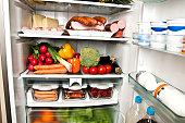 Refrigerator full of food close up