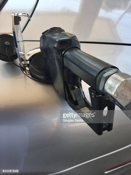 Refueling a petroleum vehicle with self serve pump and hose