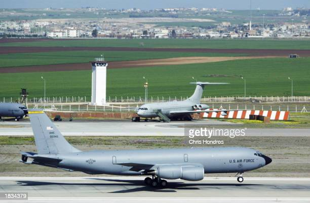 KC135 refueling jet slides in front of a control tower during takeoff March 7 2003 at Incirlik Air Force Base in Turkey Activity at Incirlik one of...