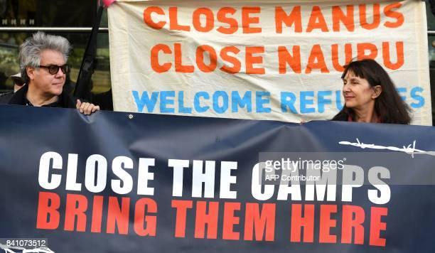 Refugee advocates take part in a protest against a government decision to cut welfare assistance to some 100 asylumseekers transported to Australia...