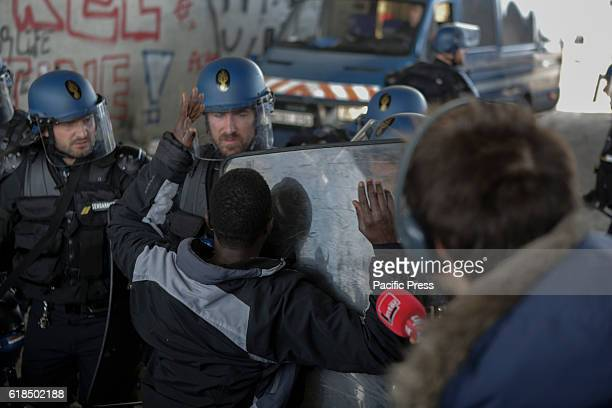 A refugee argues with an police officer about getting access to the Jungle The Jungle in Calais has been officially declared empty and closed by the...