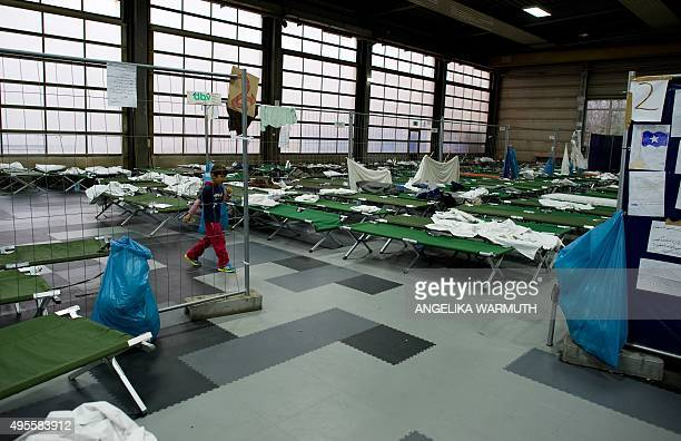 Refugee boy Arash from Afghanistan walks past camp beds at the PaulHallen registration centre for asylum seekers in Passau southern Germany on...