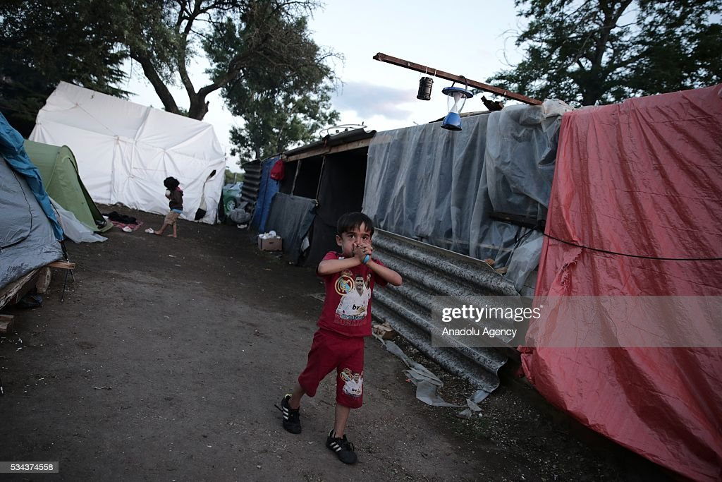 A refugee child, escaping from the evacuation in Idomeni, is seen as he waits at another refugee camp near Idomeni, Greece on May 25, 2016.