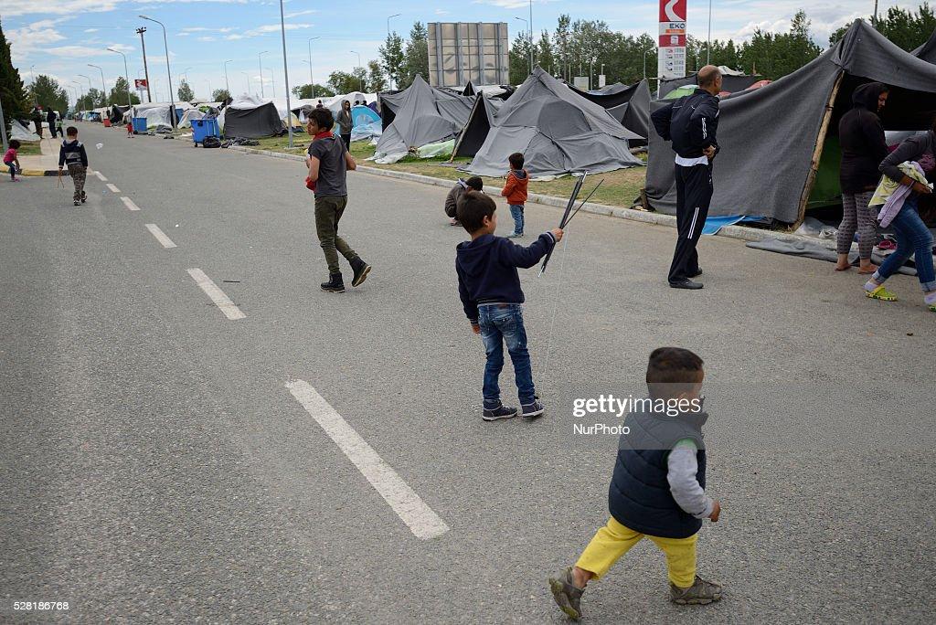 Refugee children are playing on the road at the Eco gas station makeshift refugee camp in the town of Polykastro, near the Greek Macedonian border on May 4'th, 2016.