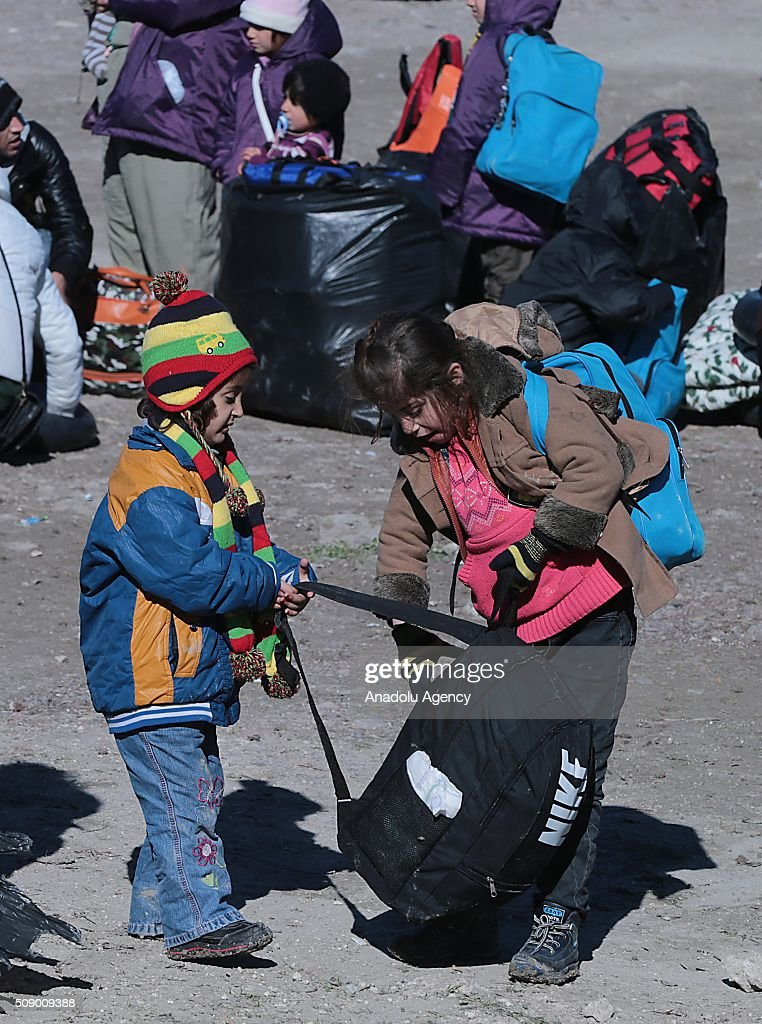 Refugee children are seen on the coast as Turkish gendarmerie captures around 700 refugees, who were trying to reach Lesbos Island of Greece, in operations conducted at 3 different bays, namely Pissa, Bahceli and Candarli, in Dikili district of Izmir, Turkey on February 8, 2016.