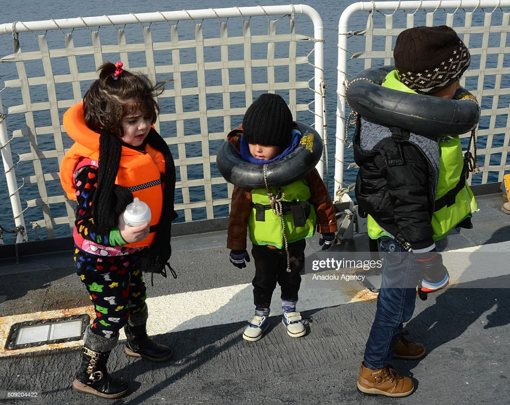 Refugee children are seen on Turkish Coast Guard ship TCSG Umut (Hope) after 54 refugees and asylum seekers were captured in the Aegean Sea, in shores of Canakkale province of Turkey, as they attempted to reach the nearby Greek islands. on February 09, 2016.