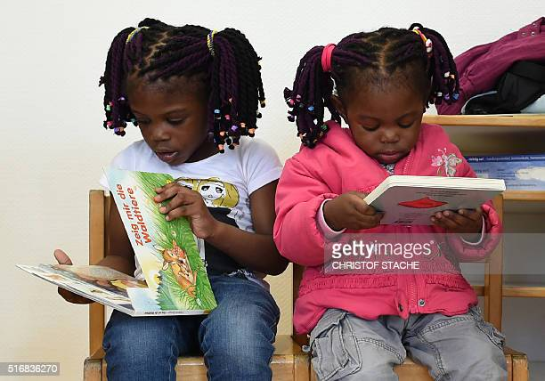 Refugee children from Nigeria read books during a first event of the threeyear program 'reading start for refugee children' in the refugee camp...