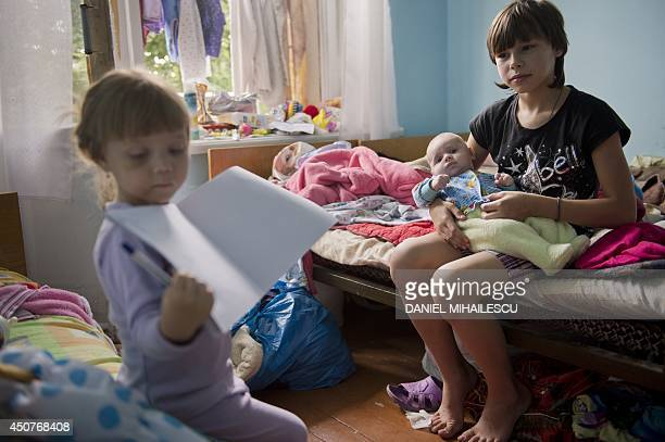 Refugee children from Sloviansk play in their room of a rest house for miners in Snizhne on June 17 2014 Around 57 people among them 31 children from...