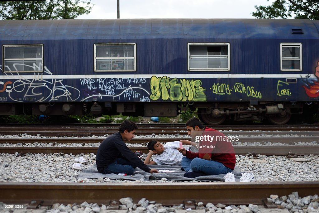Refugee children play on the rails in the old Idomeni train station on May 1'st, 2016 in Idomein refugee camp. Humanitarian conditions in the camp are deteriorating as many thousands of migrants are still located in the makeshift refugee camp, located at the Greece-Macedonia border, waiting for the border to re-open.
