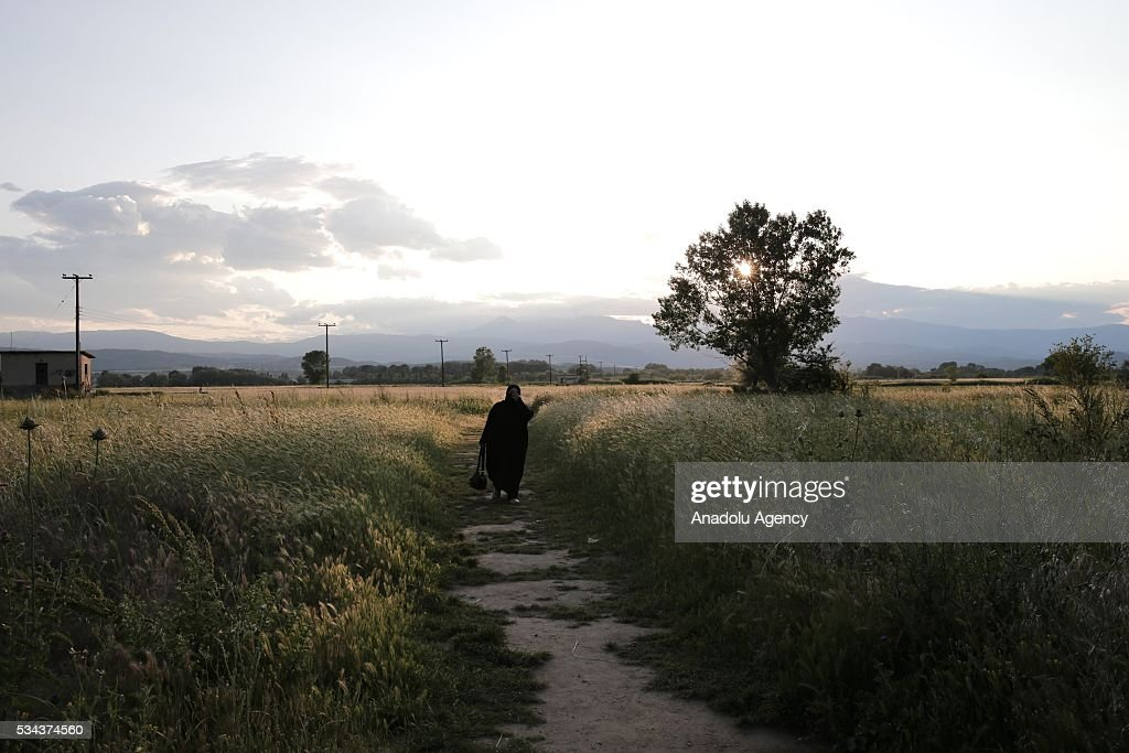 A refugee, escaping from the evacuation in Idomeni, goes to another refugee camp near Idomeni, Greece on May 25, 2016.