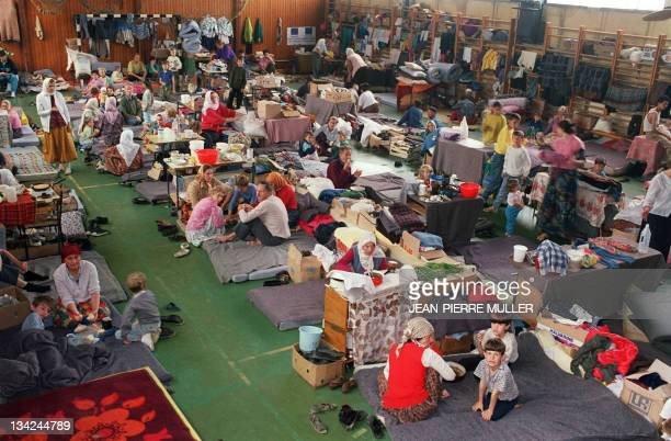 Refugee families from the Srebrenica area set up home 16 May 1993 in a gymnasium that the Tuzla authorities have put at their disposal The mainly...