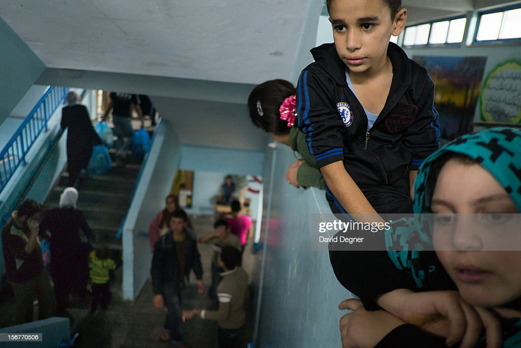 Refugee families take up residence in a school in central Gaza City on November 20, 2012 in Gaza City, Gaza. Many of the refugees are from the northern Gaza strip and were told to abandon their homes by leaflets dropped from the sky. A few of the families are returning to the same school they became refugees in 2008 during Operation Cast Lead.