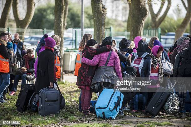 Refugee families waiting with their luggages to climb into a bus after leaving the 'Jules Ferry' center reception in Calais on November 3 2016 Over...