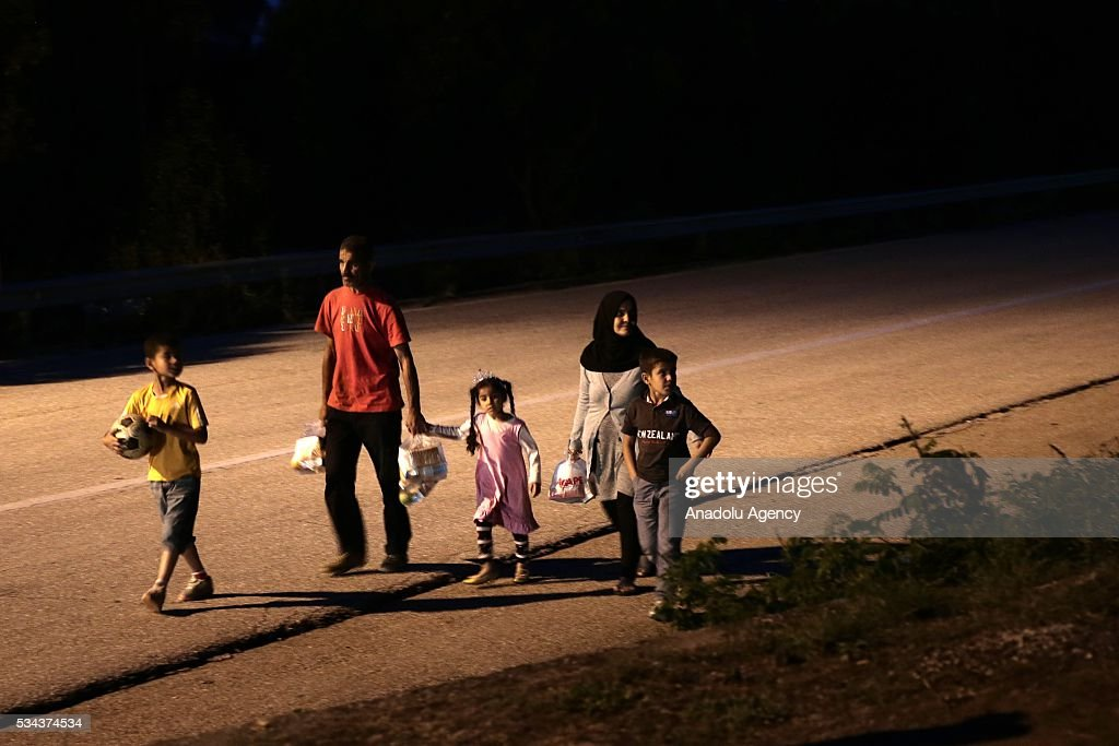 A refugee family, escaping from the evacuation in Idomeni, go to another refugee camp near Idomeni, Greece on May 25, 2016.