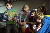 A Refugee family from a city in the Donetsk region controlled by proRussia separatists sit together in a center for refugees in the eastern Ukrainian...