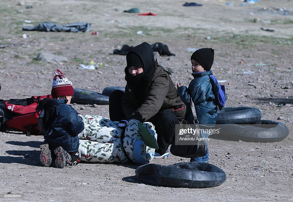 A refugee family is seen on the coast as Turkish gendarmerie captures around 700 refugees, who were trying to reach Lesbos Island of Greece, in operations conducted at 3 different bays, namely Pissa, Bahceli and Candarli, in Dikili district of Izmir, Turkey on February 8, 2016.