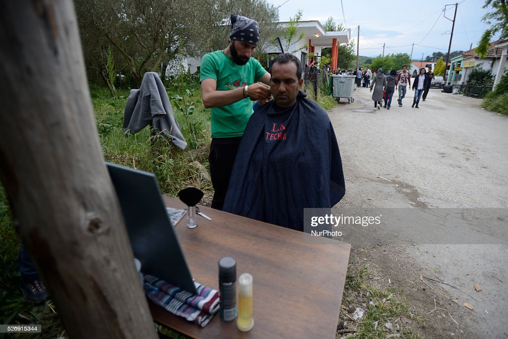A refugee is getting a haircut from another refugee on May 1'st, 2016 in Idomeni refugee camp. Humanitarian conditions in the camp are deteriorating as many thousands of migrants are still located in the makeshift refugee camp, located at the Greece-Macedonia border, waiting for the border to re-open.