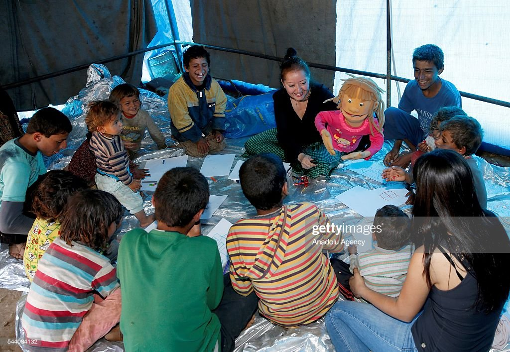 Refugee kids, fled from Syria due to ongoing civil-war, are seen as they try to live with with help of non governmental organization called 'initiative to support Refugee kids' in Izmir, Turkey on July 1, 2016.