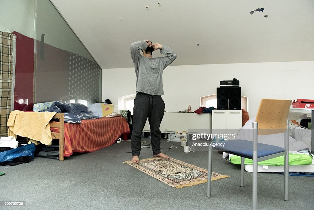 A refugee performs prayers at the Caritas refugee shelter, in Vienna, Austria on February 10, 2016. Over the last seven months, around 90,000 asylum seekers have applied for refuge in Austria, and at least 50,000 of these are expected to be deported. Military aircraft have been requisitioned for this purpose. The government also wants to cut social support to these asylum seekers.
