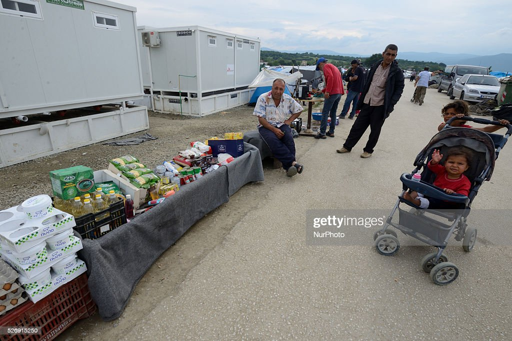 A refugee sells food products in a food stand on May 1'st, 2016 in Idomeni refugee camp. Humanitarian conditions in the camp are deteriorating as many thousands of migrants are still located in the makeshift refugee camp, located at the Greece-Macedonia border, waiting for the border to re-open.