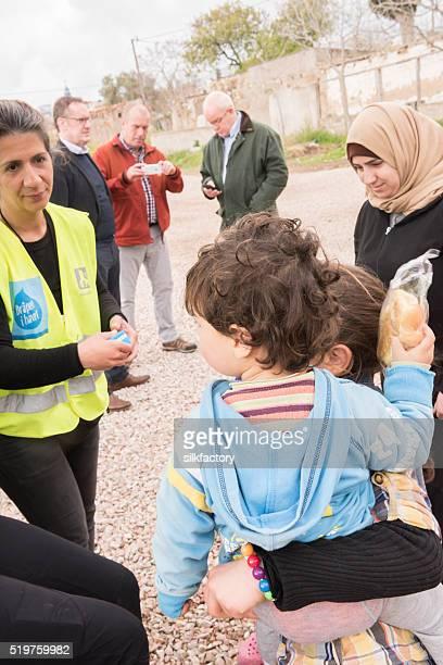Refugee sisters in breakfast line