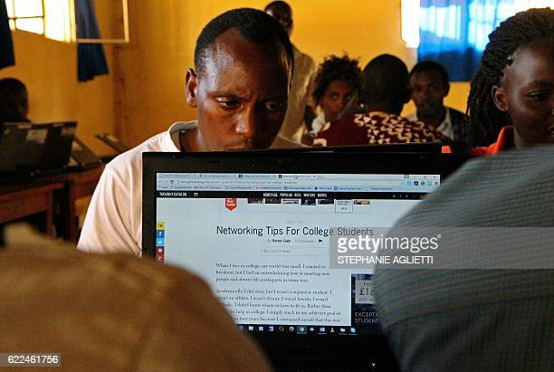 A refugee student reads on a computer on September 6 at the Kiziba camp in western Rwanda Created at the beginning of the First Congo War the camp...