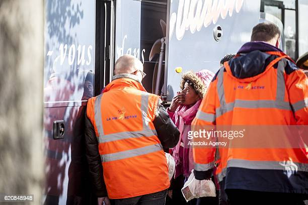 A refugee waits at the door of the bus leaving for the 'Jules Ferry' center reception in Calais on November 3 2016 Over 350 women and Their children...