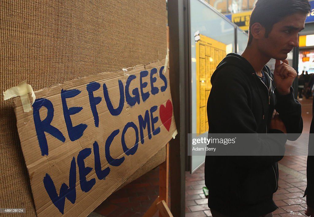 A refugee waits for further transport in Hamburg's main train station on September 19 2015 in Hamburg Germany At least 800000 migrants are expected...