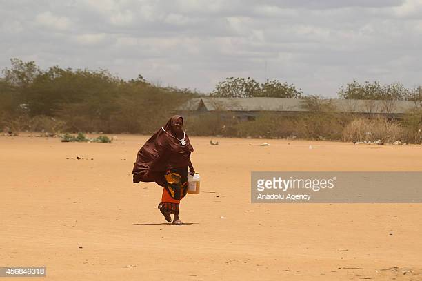 A refugee who lives in Dadaab refugee camp faces water crisis and walks to supply water in Nairobi Kenya on 4 October 2014