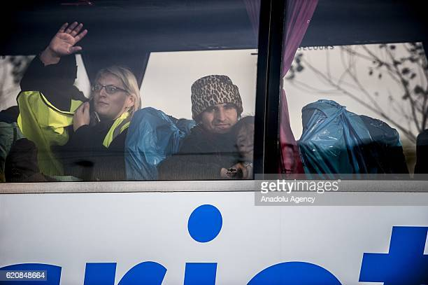 A refugee with his daughter look through the window of the bus leaving the center 'Jules Ferry' in Calais on November 3 2016 Over 350 women and Their...