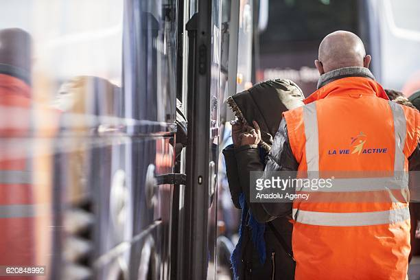 A refugee woman climb into a bus afterleaving the 'Jules Ferry' center reception in Calais on November 3 2016 Over 350 women and Their children still...