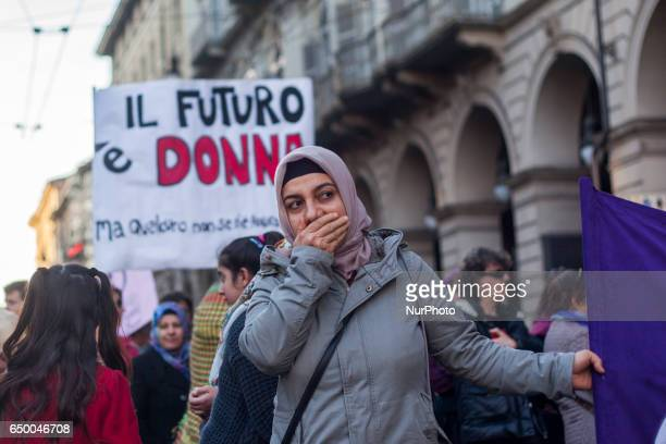 A refugee woman during a rally as part of a nationwide 'Lotto Marzo' protest on the International Women's Day 2017 in Torino Italy on March 8 2017