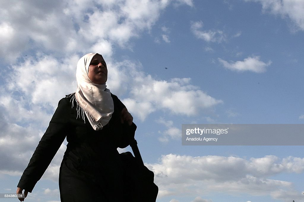 A refugee woman, escaping from the evacuation in Idomeni, goes to another refugee camp near Idomeni, Greece on May 25, 2016.