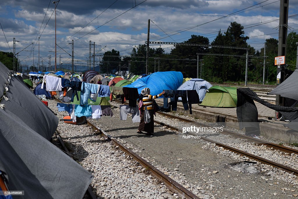 A refugee woman hangs laundry on the rails of the abandoned train station at Idomeni refugee camp on May 5'th, 2016. Thousands of migrants are still located in the makeshift refugee camp, located at the Greek Macedonian border, waiting for the border to re-open.