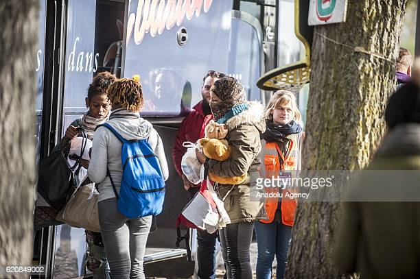 Refugee women climb into a bus afterleaving the 'Jules Ferry' center reception in Calais on November 3 2016 Over 350 women and Their children still...