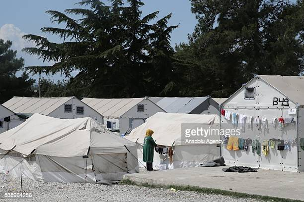 Refugee women hangs out the laundry at Diavata refugee camp in Thessaloniki Greece on June 6 2016