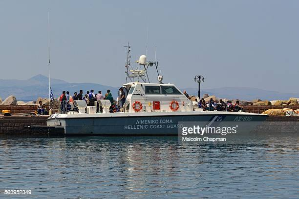 Refugees and asylum seekers having been picked up by Greek Coastguard in Molyvos Mytilene Greece after crossing the straits from Turkey The...