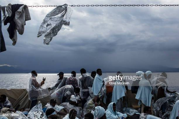 Refugees and migrants are seen on board the Migrant Offshore Aid Station 'Phoenix' vessel as they approach Italy on May 26 2017 off Crotone Italy The...