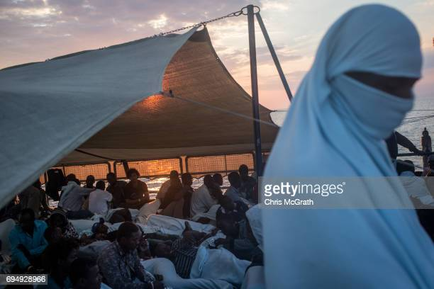 Refugees and migrants are seen onboard the Migrant Offshore Aid Station Phoenix vessel enroute to Italy on June 11 2017 off Catania Italy An...