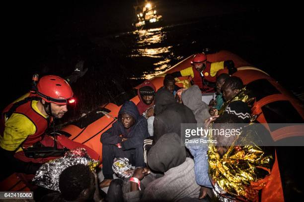 Refugees and migrants are transferred to the Spanish Proaciva Open Arms NGO rescue vessel Golfo Azzurro after being rescued by the Italian Coast...