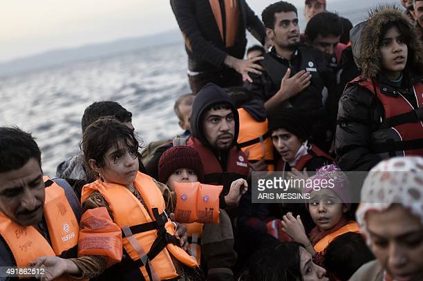 Refugees and migrants arrive at the Lesbos island after crossing the Aegean Sea from Turkey on October 8 2015 Europe is grappling with its biggest...