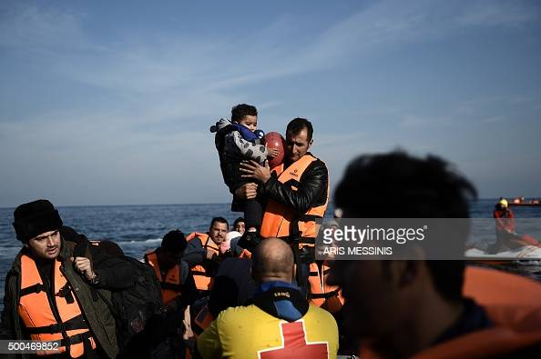 Refugees and migrants arrive in the island of Lesbos after crossing the Aegean Sea from Turkey on December 8 2015 At least six children died on...