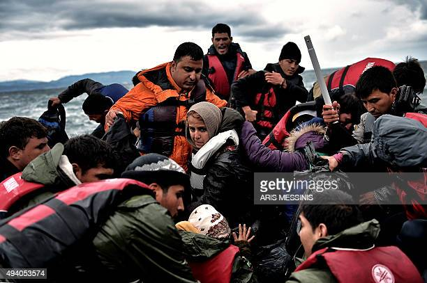 Refugees and migrants arrive on the Greek island of Lesbos after crossing the Aegean sea from Turkey on October 24 2015 Bulgaria Romania and Serbia...