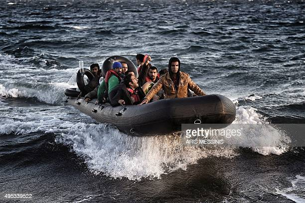 Refugees and migrants arrive on the Greek island of Lesbos after crossing the Aegean Sea from Turkey on November 2 2015 More than 218000 migrants and...