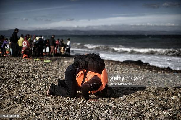 Refugees and migrants arrive on the Greek Lesbos island after crossing the Aegean Sea from Turkey on October 31 2015 AFP PHOTO / ARIS MESSINIS