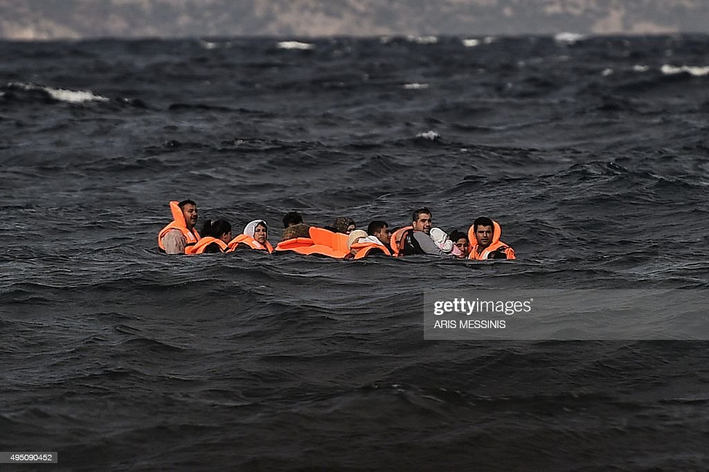 Refugees and migrants cross by boat the Aegean sea from Turkey to reach the Greek island of Lesbos on October 31 2015 AFP PHOTO / ARIS MESSINIS