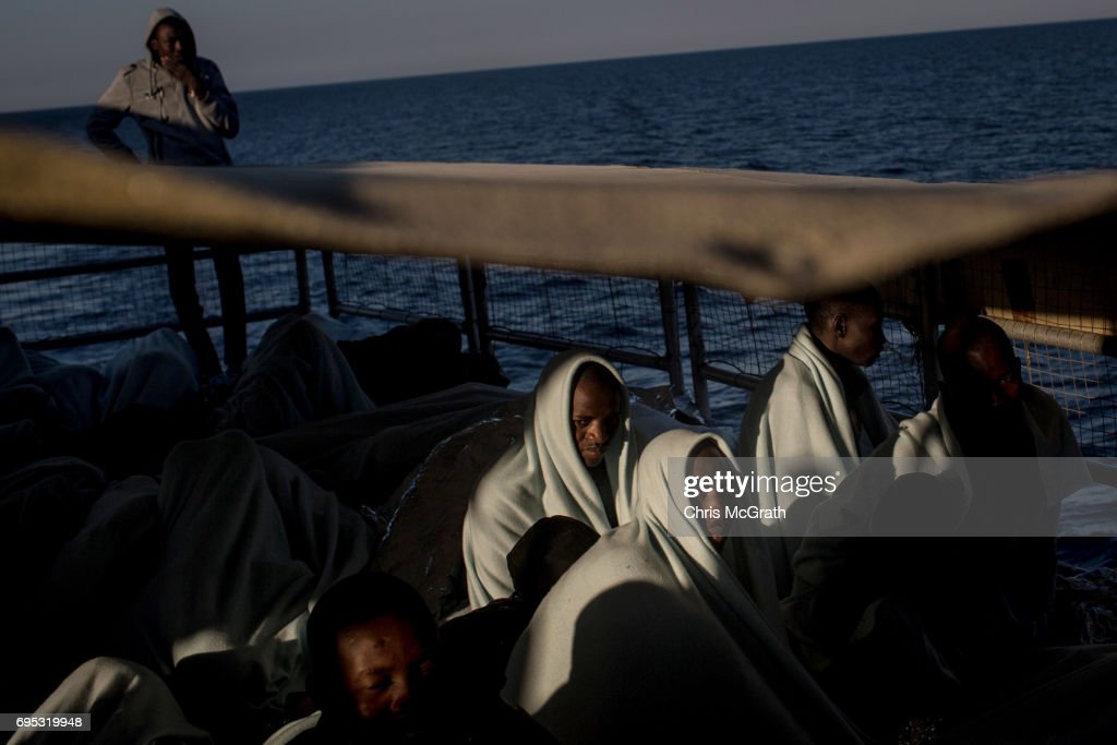 Refugees and migrants look out at Italy as they arrive in port on the Migrant Offshore Aid Station (MOAS) Phoenix vessel on June 12, 2017 in Reggio Calabria, Italy. An estimated 230,000 refugees and migrants will arrive in Italy this year as numbers of refugees and migrants attempting the dangerous central mediterranean crossing from Libya to Italy continues to rise since the same time last year. So far this year more than 58,000 people have arrived in Italy and 1,569 people have died attempting the crossing. Libya continues to be the primary departure point for refugees and migrants taking the central mediterranean route to Sicily. In an attempt to slow the flow of migrants, Italy recently signed a deal with Libya, Chad and Niger outlining a plan to increase border controls and add new reception centers in the African nations, which are key transit points for migrants heading to Italy. MOAS is a Malta based NGO dedicated to providing professional search-and-rescue assistance to refugees and migrants in distress at sea. Since the start of the year MOAS have rescued and assisted more than 4000 people and are currently patrolling and running rescue operations in international waters off the coast of Libya.