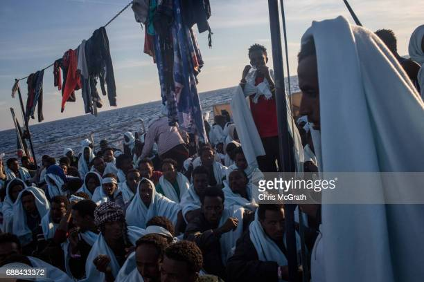 Refugees and migrants rest on board the Migrant Offshore Aid Station 'Phoenix' vessel on May 25 2017 off Lampedusa Italy The crew of the 'Phoenix'...