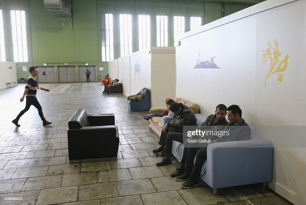 Refugees and migrants seeking asylum in Germany while away time among cubicles that contain bunk beds and offer at least some privacy in Hangar 2 at former Tempelhof Airport on February 11, 2016 in Berlin, Germany. Tempelhof, once an airport in the city center and first built in the 1930s, now houses approximately 2,600 refugees in three former hangars. Berlin city authorities recently approved plans to expand its capacity to house the newcomers with an additional 90 shelters with space for 30,000 people. An estimated 50,000-80,000 migrants and refugees already live in Berlin. Germany received 1.1 million refugees and migrants in 2015 and is expecting to continue to receive large numbers in 2016.